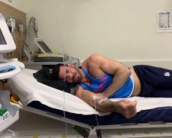 Billy Santoro in a hospital bed in Australia