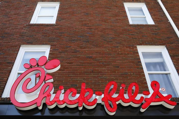 Chick-fil-A signage is displayed in downtown, Athens, Ga.