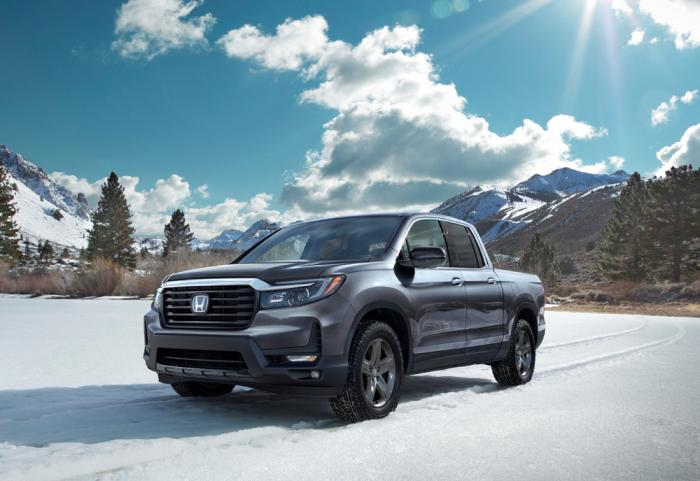 This photo from Honda shows the 2021 Honda Ridgeline RTL-E, a midsize pickup with innovative features such as a stereo system inside the truck bed