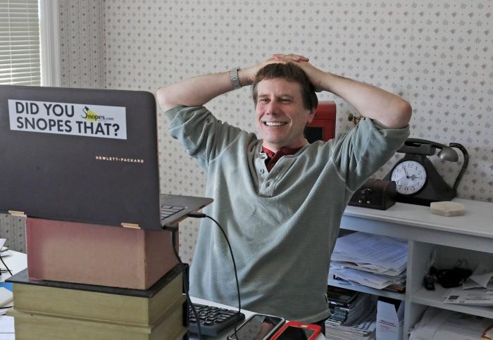 David Mikkelson, founder of Snopes, the site that tracks fakery on the web is shown in his home office in a nearly 100-year old home in Tacoma, Sept. 25, 2018. (Greg Gilbert/The Seattle Times via AP)